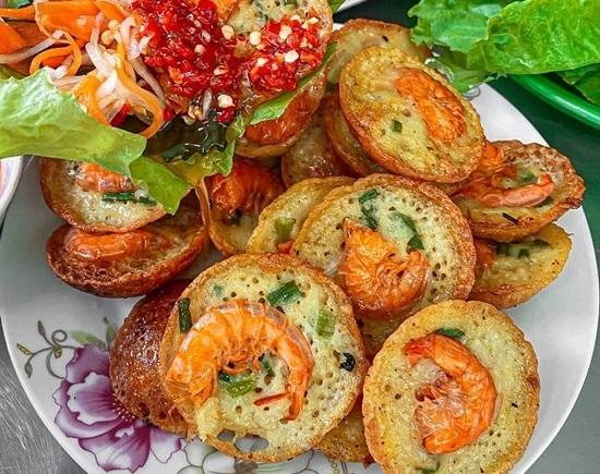 One-cent shrimp pancakes sizzle up Saigon street food scene